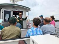 Ranger Adam Mathews talks to visitors on the Life on the Lake tour.