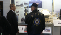 Chinh Pham and Don Rowe viewing the USS Duluth exhibit at the Duluth Depot.